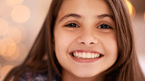 young girl with bashful smile