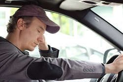Exhausted man falling asleep while driving