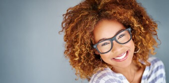 Young lady sporting glasses with stunning smile